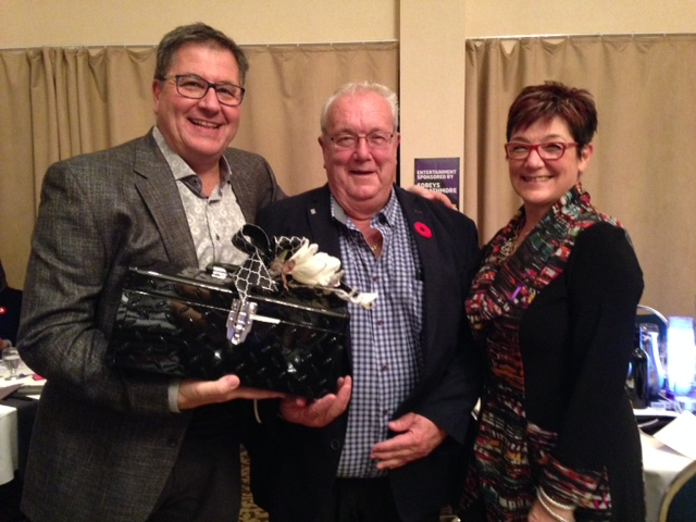 Perry & Cindy Banadyga (Home Hardware) with raffle winner Steve Grajczyk who won $750 in decor (and donated it back to the Society!)