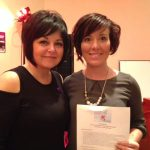 Society CEO, Wanda McGinnis with raffle winner Karie Schultz who won a $1000 Air Canada Gift Card sponsored by Gates Agencies.